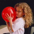 Child Holding Bowling Ball